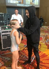"""Cameron Voorhees with Lex Ishimoto, a 2017 """"So You Think You Can Dance"""" television show champion, at The Dance Awards in Orlando, Florida on July 19, 2018."""