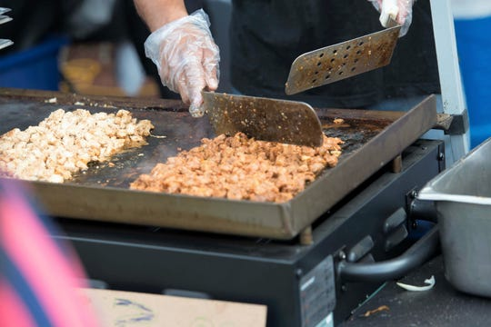 Chicken and pork al pastor are cooked before being used to fill tacos at the 2017 HOLA fest.