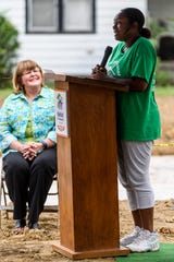 Tamisha Dilworth thanks the crowd attending the groundbreaking for her future home, which will be the 500th house built by Habitat for Humanity of Evansville, in the city's Ballard Neighborhood, Wednesday morning, Aug. 15, 2018. Dilworth is excited to decorate and create memories in a new home with her three children, Aliyah, 11, Travon, 8, and Teresa, 1.