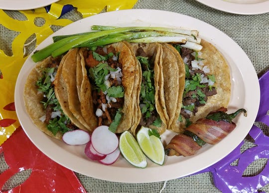 Tacos Juarez style from Azteca, with a bacon-wrapped jalapeno and grilled green onions.