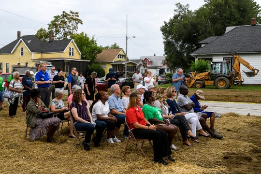 Community members attend the groundbreaking celebration honoring Habitat for Humanity of Evansville's 500th home build in the city's Ballard Neighborhood, Wednesday morning, Aug. 15, 2018. Evansville's Habitat for Humanity chapter will be the 26th affiliate across the nation to accomplish building 500 local homes.
