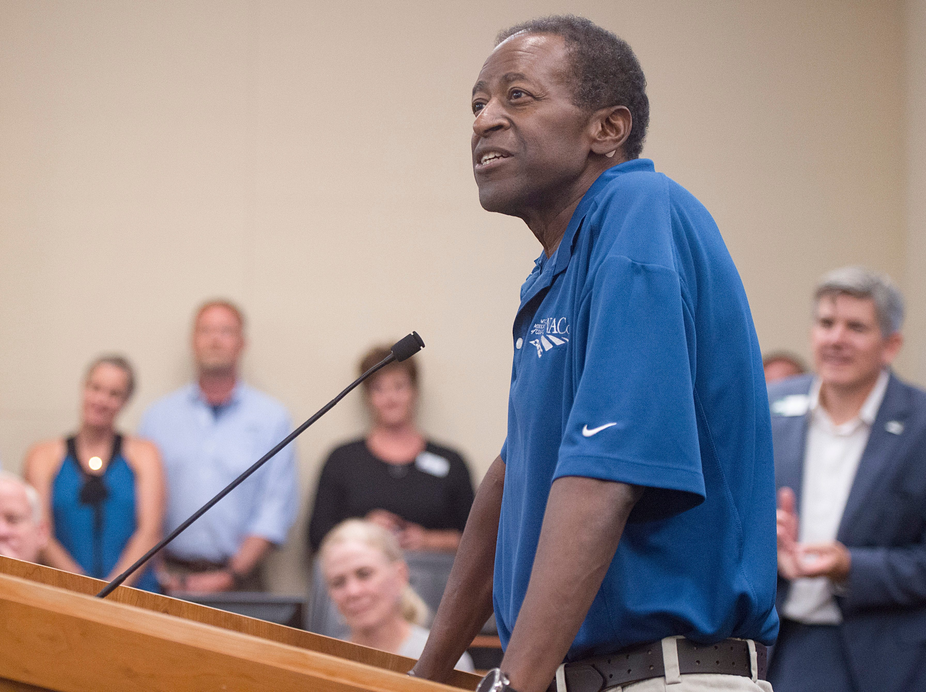 County Commissioner Lew Gaiter III speaks to friends and colleagues at a gathering to celebrate his life at the Larimer County Courthouse on Wednesday, August 15, 2018. Gaiter III was given six to 12 weeks to live after the cancer he has had for nearly a decade began to take its toll earlier this month.
