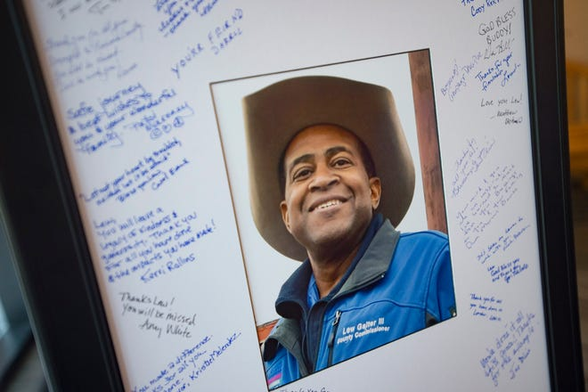 Signatures and messages line a portrait of County Commissioner Lew Gaiter III as friends and colleagues gather to celebrate his life at the Larimer County Courthouse on Wednesday, August 15, 2018. Gaiter III was given six to 12 weeks to live after the cancer he has had for nearly a decade began to take its toll earlier this month.
