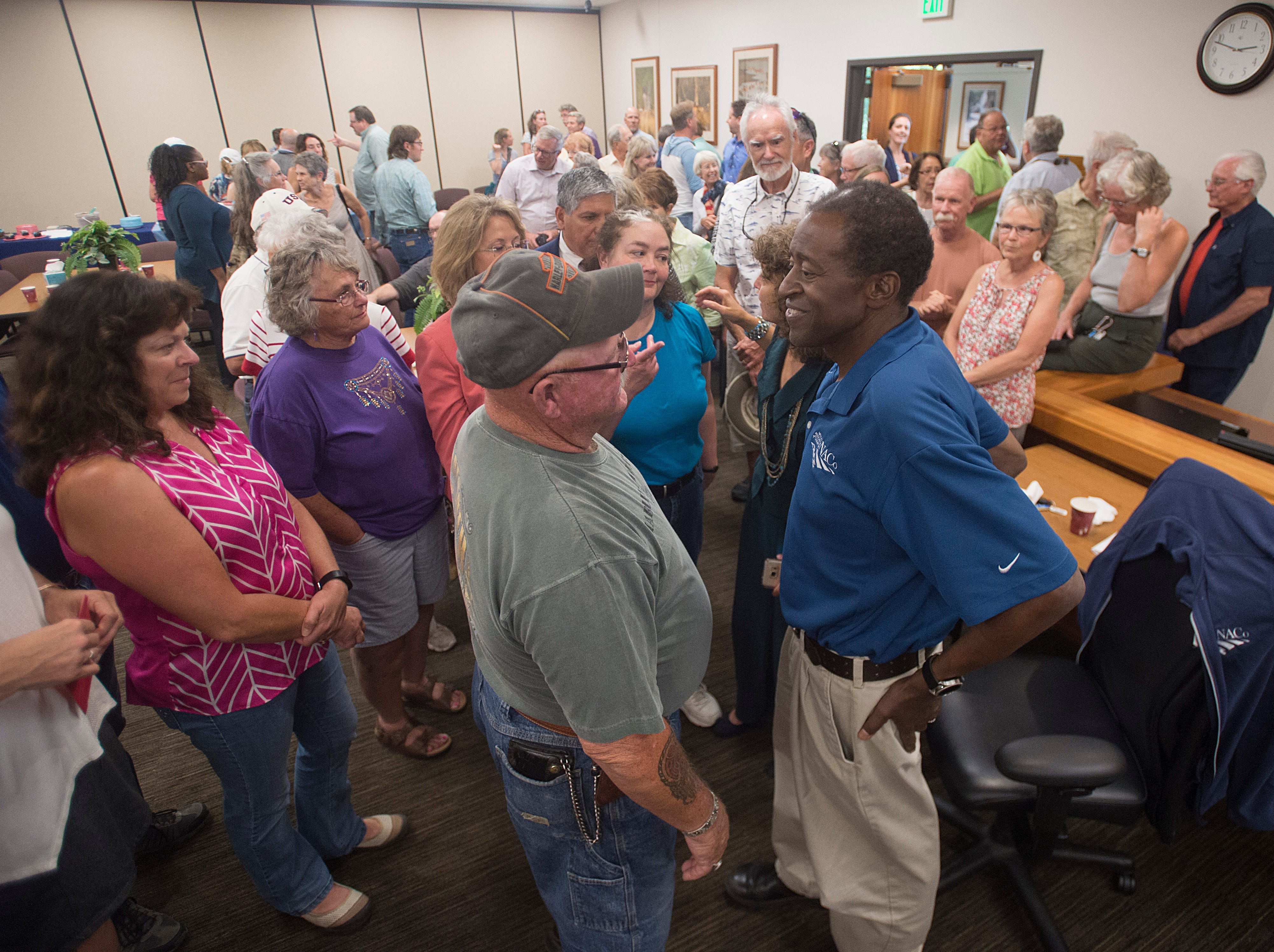 County Commissioner Lew Gaiter III chats with Pat Young as people crowd around during a gathering to celebrate his life at the Larimer County Courthouse on Wednesday, August 15, 2018. Gaiter III was given six to 12 weeks to live after the cancer he has had for nearly a decade began to take its toll earlier this month.