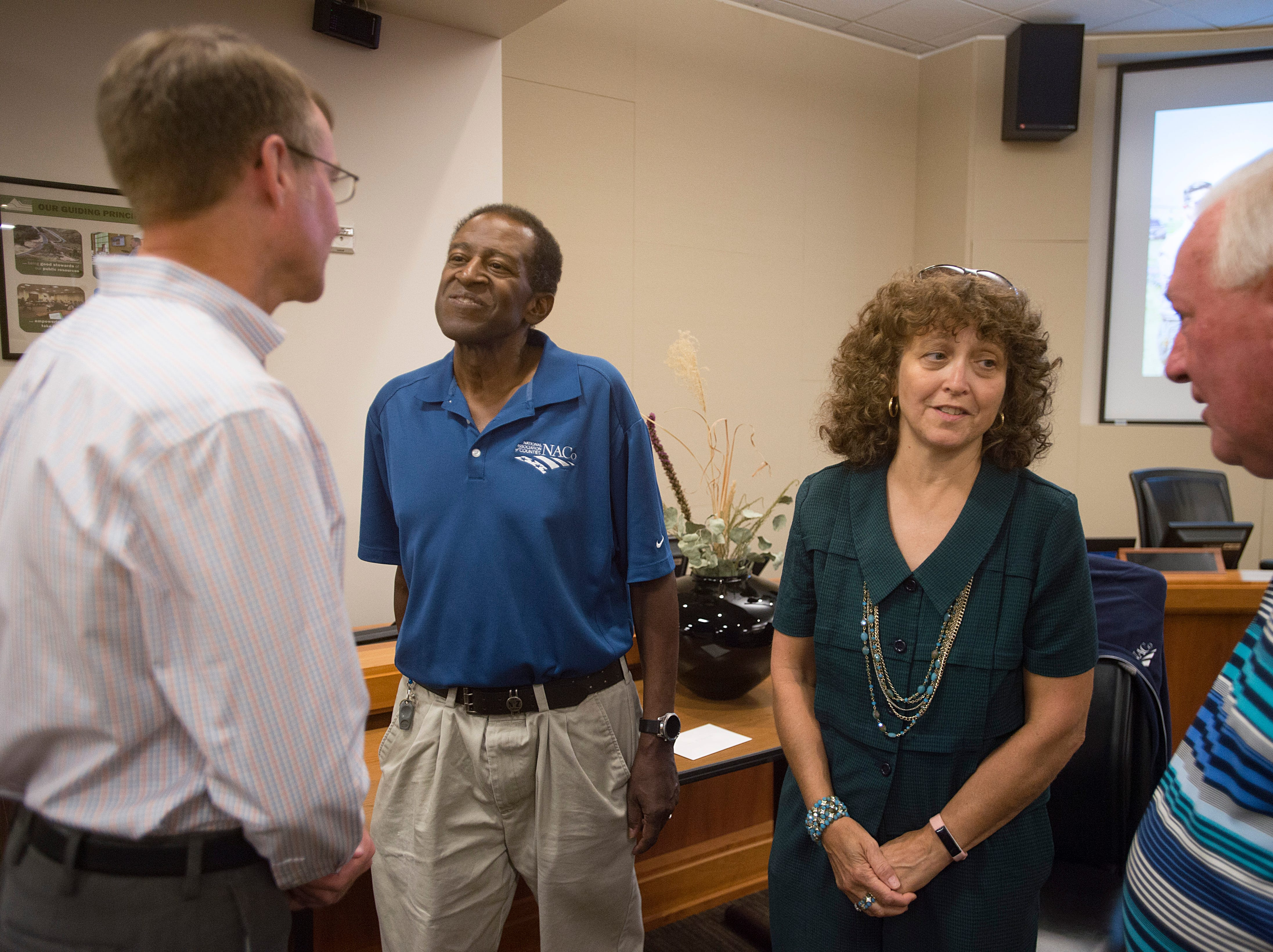 County Commissioner Lew Gaiter III and his wife Jeannette visit with friends and colleagues at a gathering to celebrate his life at the Larimer County Courthouse on Wednesday, August 15, 2018. Gaiter III was given six to 12 weeks to live after the cancer he has had for nearly a decade began to take its toll earlier this month.
