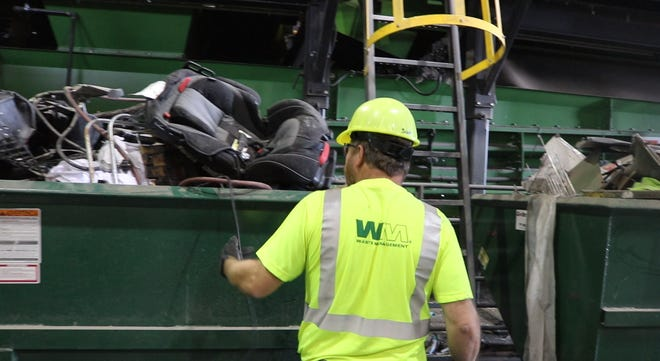 Scott Mercer, Materials Recycling Facility Manager for Waste Management in Fort Collins shows entire dumpster bins filled with non-recyclable items sorted in the recycling center on Aug. 15, 2018. Contamination of recycling has become a bigger issue in Larimer county as more and more residents do not mindfully sort recycling and trash materials properly.