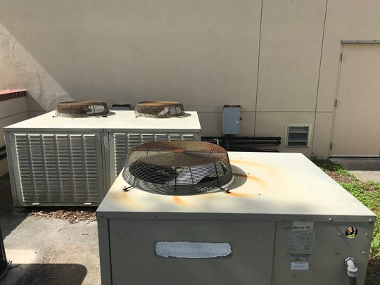 Old air conditioning units at Tropic Isles Elementary.