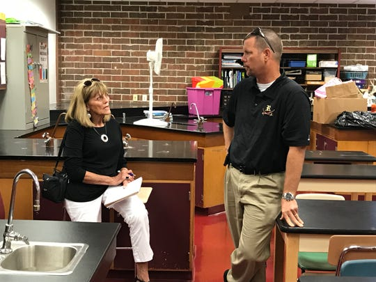 Former Lee schools superintendent Bobbie D'Alessandro, left, talks with Riverdale High Principal Scott Cook in a science lab at the school. The lab also is in need of repairs.