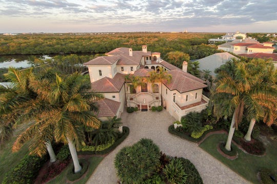 This home is one of 75 houses on Connie Mack Island and has 6,045 air-conditioned square feet.