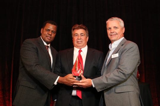 Michael Chatman and Brian Gomer present an award to Brian Rist at the 2017 Excellence in Nonprofit Performance Yearly awards (The ENPYs).