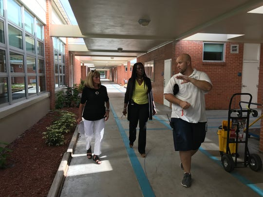 Former Lee schools superintendent Bobbie D'Alessandro, left, walks with Franklin Park Elementary Principal Mischelle Freeman and building supervisor James Busscher during a tour of the school recently to look at damage.
