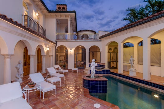 One of the best features is the private courtyard on the first floor that features a pool and spa.