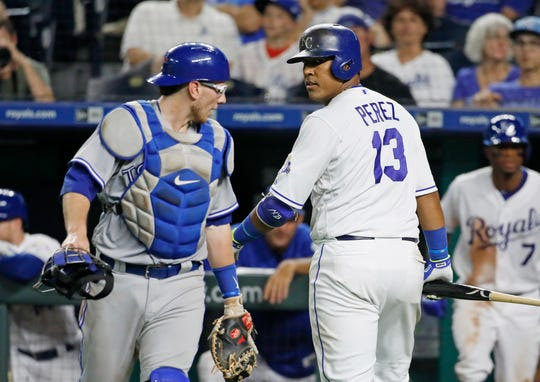 Kansas City's Salvador Perez, right,  looks back at Blue Jays catcher Danny Jansen as they exchange words after Perez was out on a popup in the eighth inning Monday night.