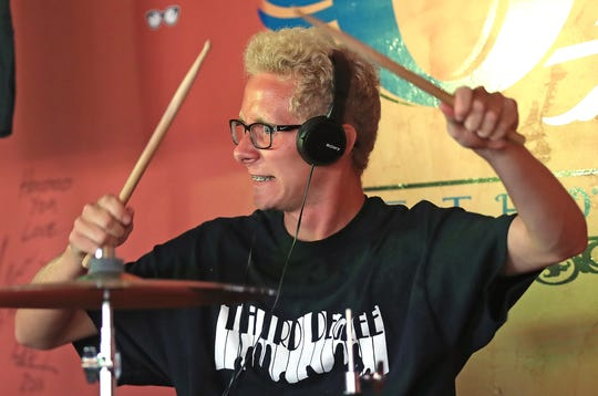 Third Degree drummer Nick May brings intensity to his music as he plays with the band  July 26 at The Blue Opus in Bellevue.