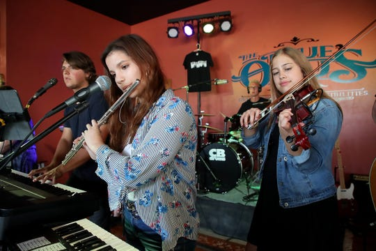 Third Degree flutist Sarah Swan, center, plays with singer Logan Zills, drummer Nick May and violinist Kate Stenson July 26 at The Blue Opus in Bellevue.