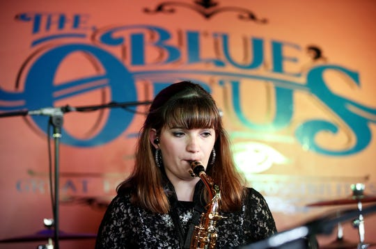 Third Degree saxophonist Hannah Swan plays with the band Thursday at The Blue Opus in Bellevue.