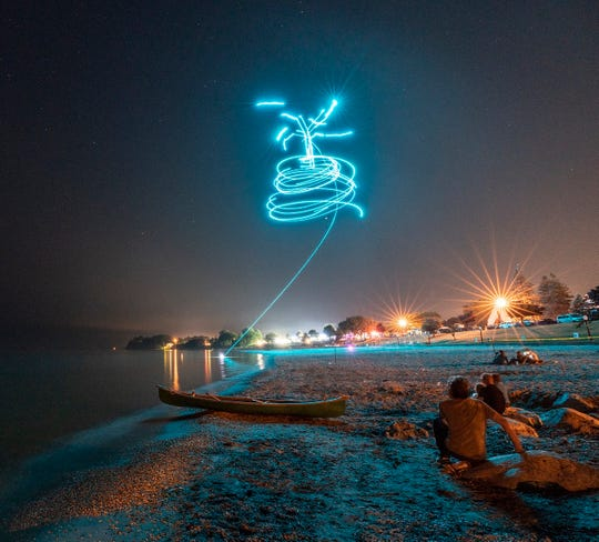 One can follow the light trail as one of the drones crashed into Lake Michigan in Shawn Hayes-Costello's photo. He used a long exposure and tripod.