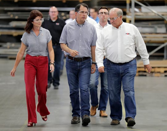Wisconsin Gov. Scott Walker and Lt. Gov. Rebecca Kleefisch tour the facilities at Fox Valley Metal Tech Wednesday, August 15, 2018 in Ashwaubenon, Wis.,