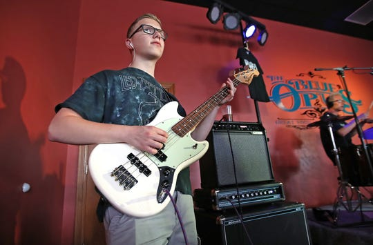 Third Degree guitarist Presley Christman plays at The Blue Opus in Bellevue.