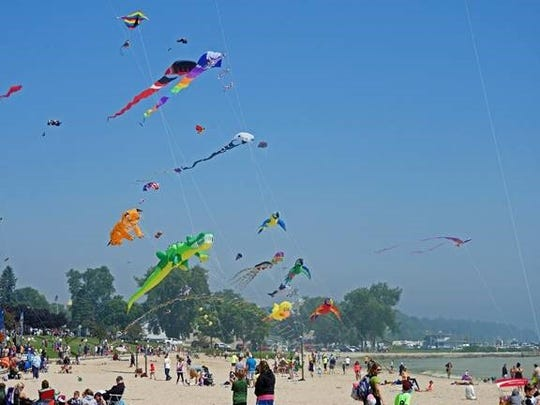 "Giant kites soar over Crescent Beach on the Lake Michigan shore in Algoma during last year's ""Soar on the Shore"" kite festival. This year's festival takes place Aug. 18."
