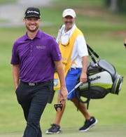 Kyle Thompson smiles as he plays at Furman during the first day of the BMW Charity Pro-Am Thursday, May 18, 2017.