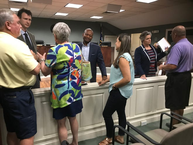 Simpsonville elected officials talk with business owners and members of the public on Tuesday, Aug. 14, 2018 at Simpsonville City Hall.