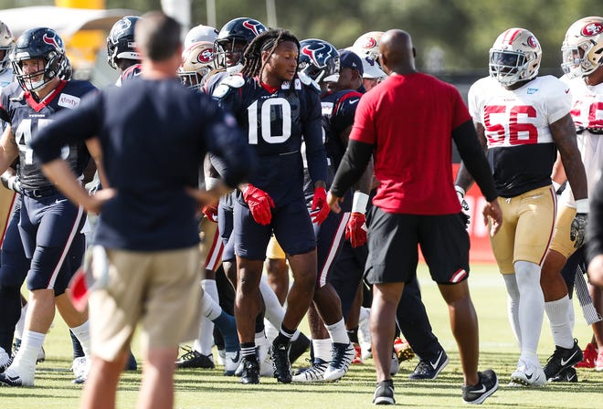 Houston Texans wide receiver DeAndre Hopkins (10) emerges from an altercation with San Francisco 49ers defensive back Jimmie Ward, not shown, during a joint NFL football practice in Houston, Wednesday, Aug. 15, 2018.
