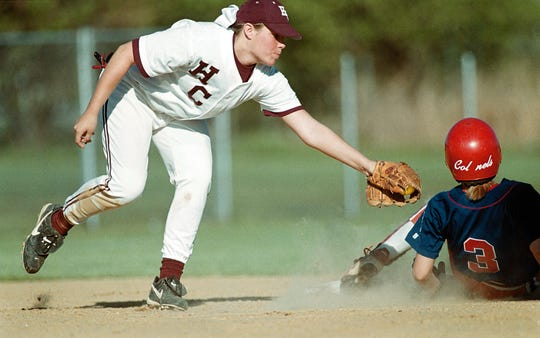 Lyndsay Howard Koonce, one of the 2018 inductees into the Henderson County Sports Hall of Fame, tries to tag Christian County's Leigh Cansler in a game during the 1999 season.