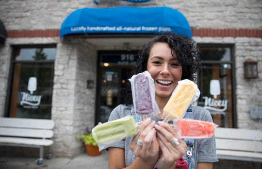 Erica Guerrero poses with four different ice cream treats at Nicey, where she works in Broad Ripple, Wednesday, Aug. 15, 2018.