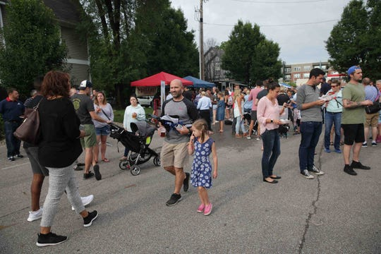 Guests mix and mingle during the Fall Creek Block Party held at the intersection of Talbott St. and 22nd St. in Indianapolis on Friday, June 23, 2017.