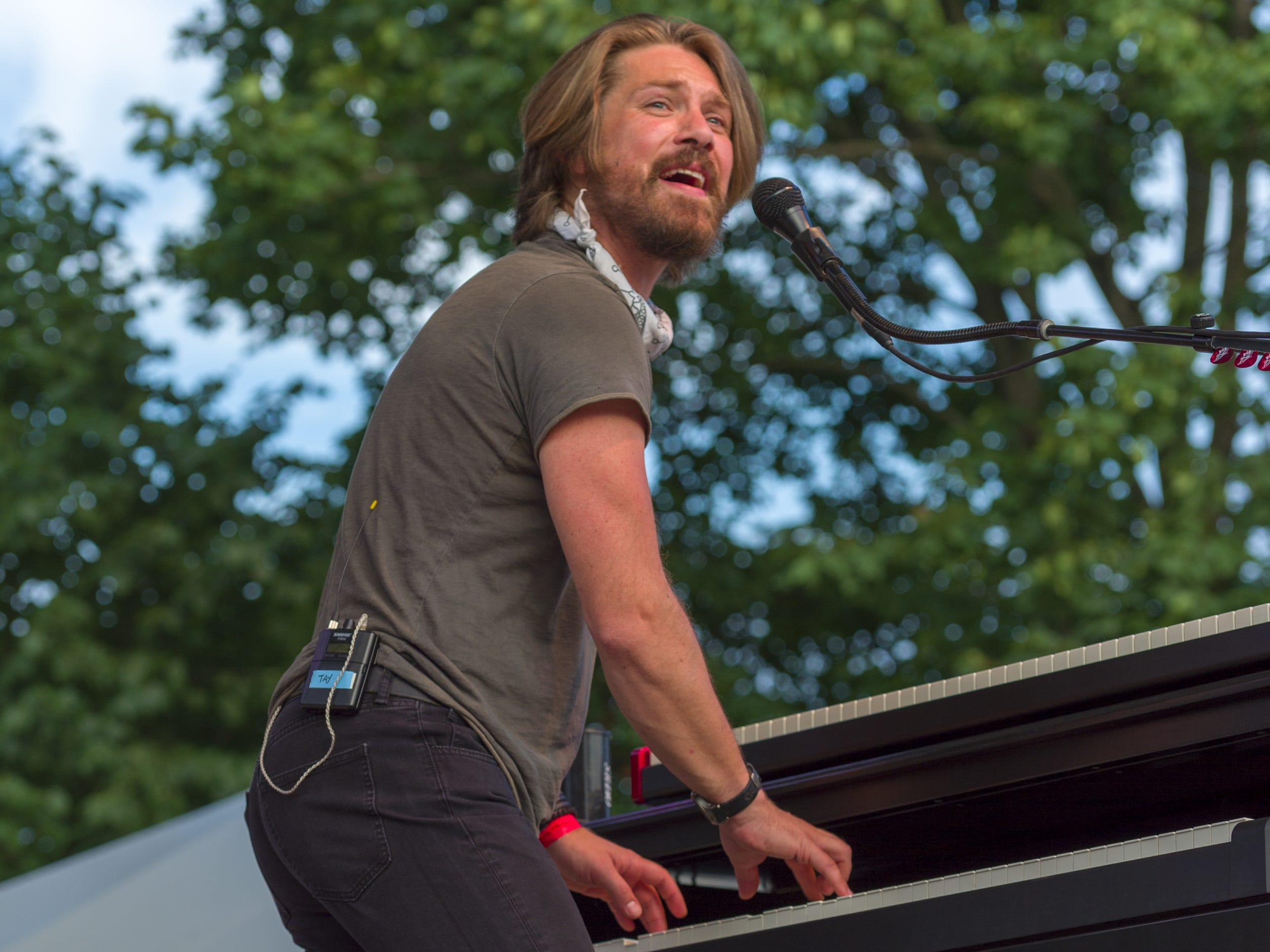"Taylor Hanson, piano and singer, performs on stage. Hanson, a trio of siblings known for the No. 1 hit in 1997 titled ""MMMBop"" performed at the Indiana State Fair, Friday, Aug. 10, 2018, on the Chevrolet Free Stage."