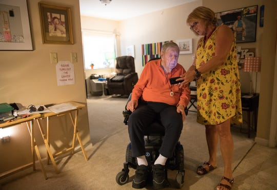 Keith Bratton, an illustrator who ran an ad agency for years, visits with his daughter-in-law Dawn Bratton, who lives in Indianapolis and visits Keith a few times a month at his home in an assisted living location in Fishers, Wednesday, Aug. 15, 2018.