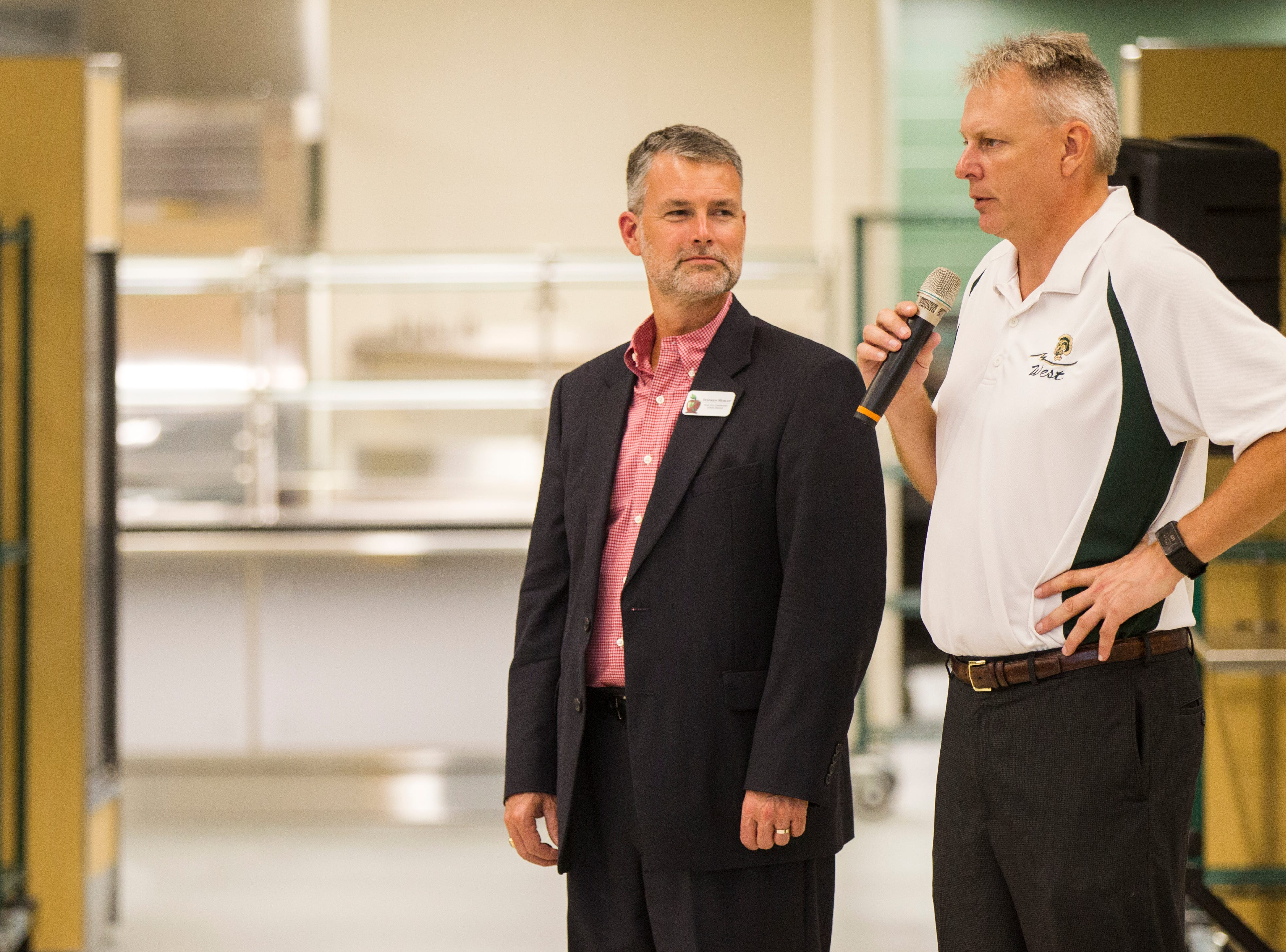 Gregg Shoultz, West High principal, (right) introduces Stephen Murley, Iowa City Community School District superintendent, during a tour of a recently completed addition to facilities on Wednesday, Aug. 15, 2018, at West High School in Iowa City. The addition was the first phase of renovations set to take place for the building that opened in 1968.