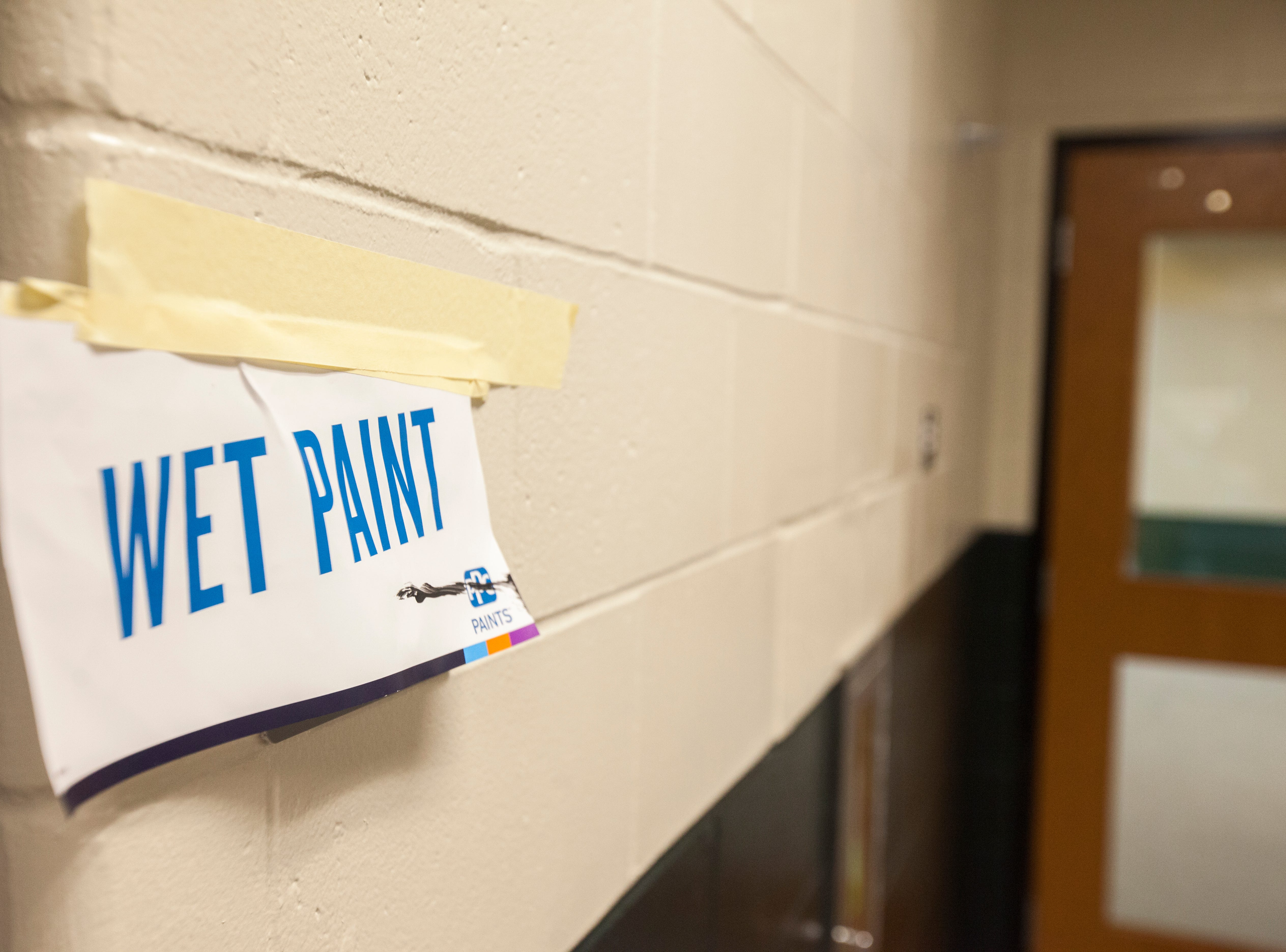 A sign warns of recent paint during a tour of a recently completed addition to facilities on Wednesday, Aug. 15, 2018, at West High School in Iowa City. The addition was the first phase of renovations set to take place for the building that opened in 1968.