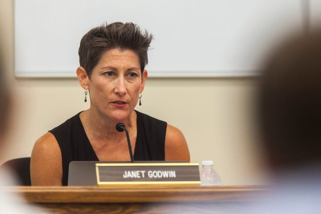 """Janet Godwin, school board president, is seen during a board meeting during a districtwide rezoning on Tuesday, Aug. 14, 2018. On Oct. 16, the board president  described the board's progress as """"a very solid step in the right direction."""""""