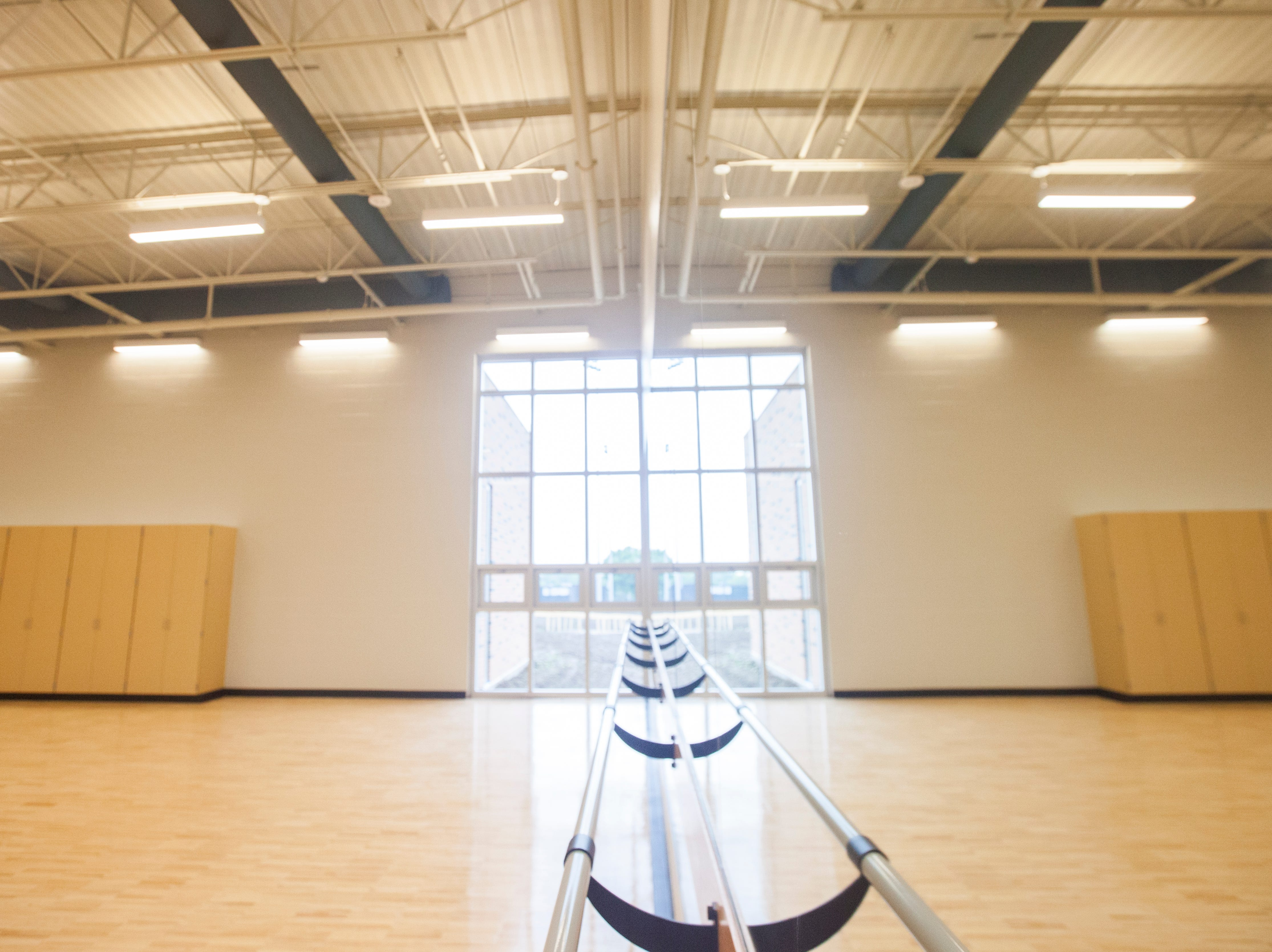 A portion of a new dance room is reflected in a large mirror during a tour of a recently completed addition to facilities on Wednesday, Aug. 15, 2018, at West High School in Iowa City. The addition was the first phase of renovations set to take place for the building that opened in 1968.