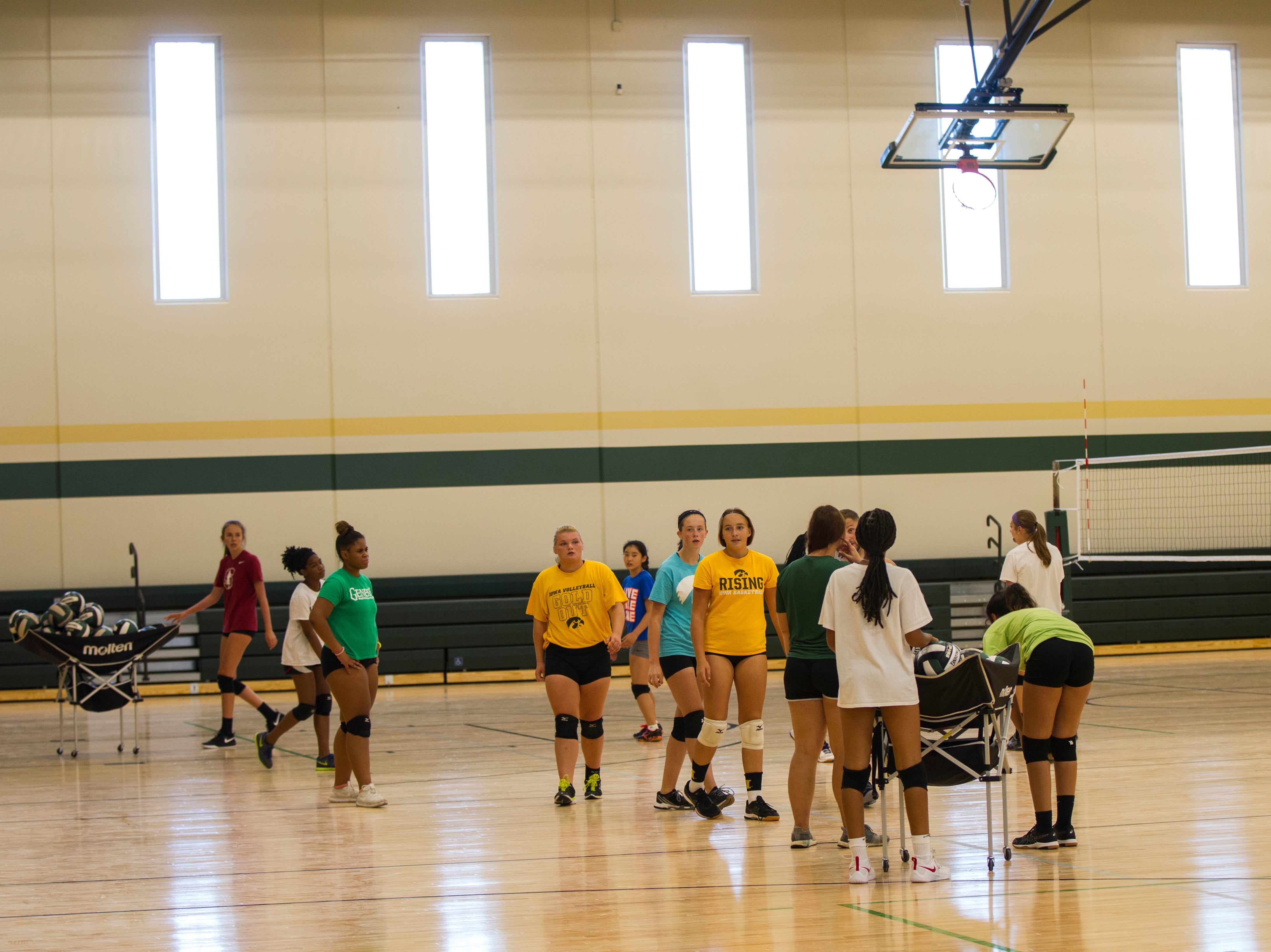 West High volleyball players practice in a new practice gym during a tour of a recently completed addition to facilities on Wednesday, Aug. 15, 2018, at West High School in Iowa City. The addition was the first phase of renovations set to take place for the building that opened in 1968.