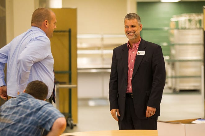 Stephen Murley, Iowa City Community School District superintendent, smiles during a tour of a recently completed addition to facilities on Wednesday, Aug. 15, 2018, at West High School in Iowa City. The addition was the first phase of renovations set to take place for the building that opened in 1968.