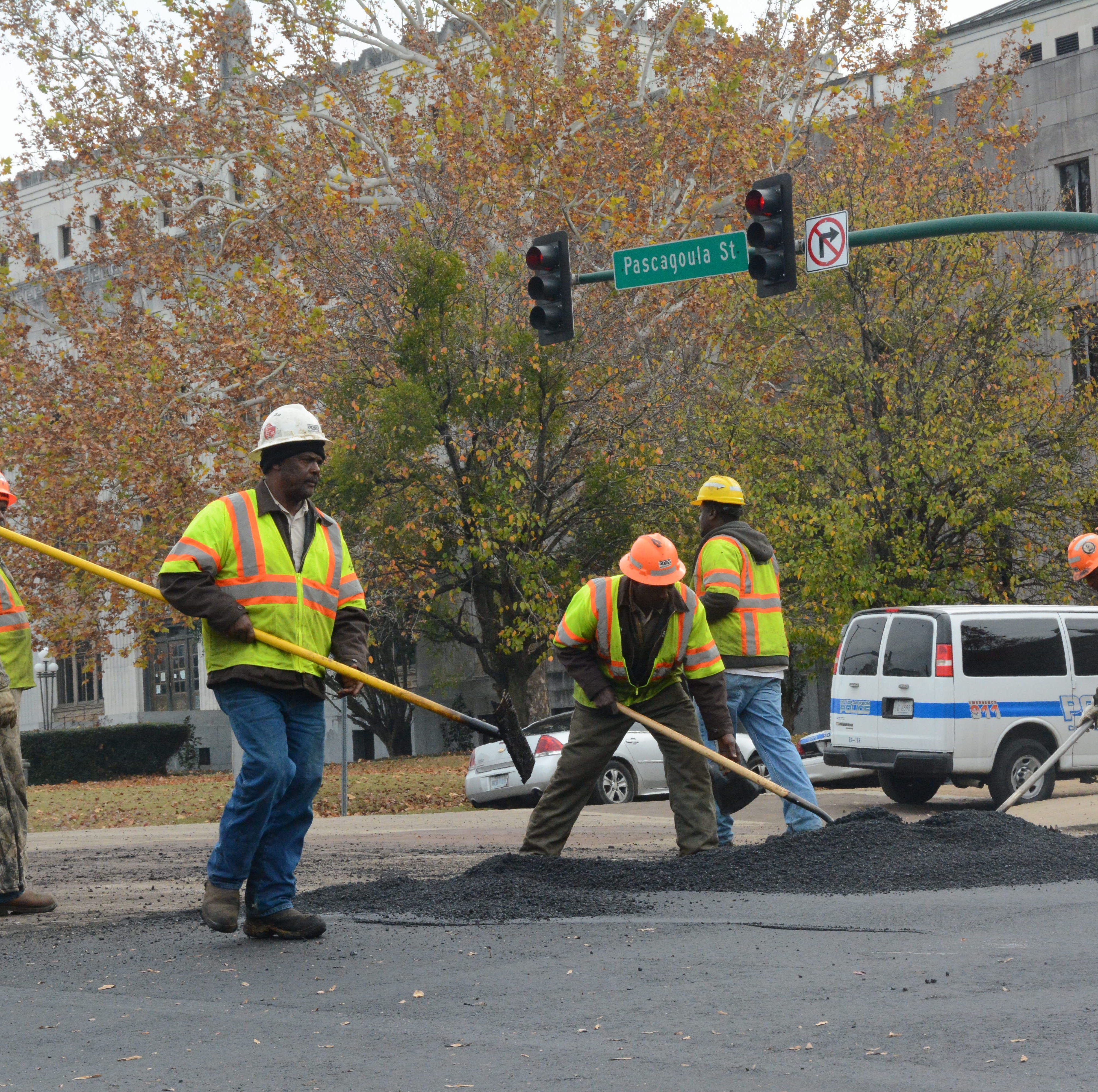 Jackson city workers, like these public works employees seen here repaving Pearl Street in downtown Jackson on Dec. 20, 2017, will be getting a 2 percent pay boost, under a proposal the Jackson City Council discussed during budget talks Wednesday, Aug. 15, 2018.
