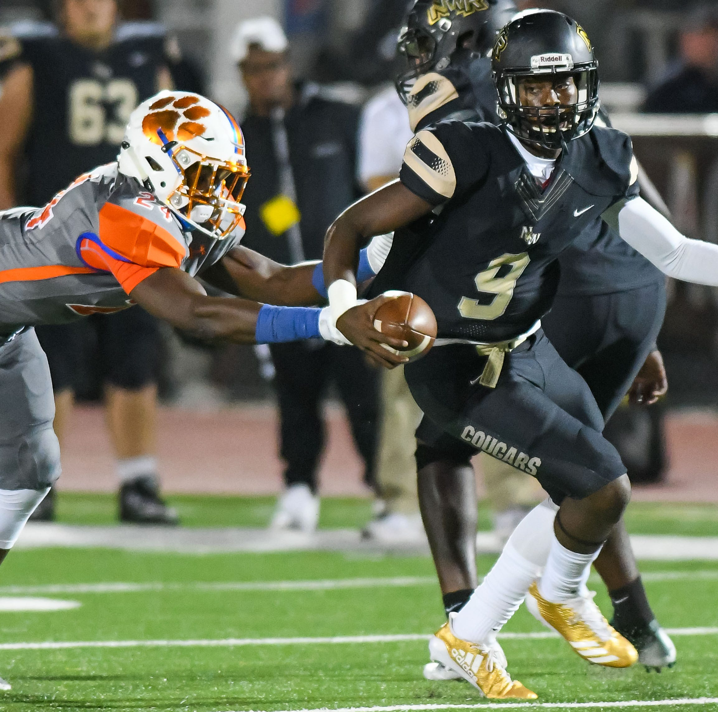 Northwest Rankin quarterback Jamari  Jones (9) runs the ball against Madison Central during game action Thursday, October 26th, 2017 in Flowood, MS.(Bob Smith-For the Clarion Ledger)