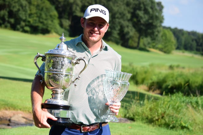Aaron Ingalls poses with the Martin Condon Trophy he received after winning the Tennessee Amateur Championship last week in Collierville.