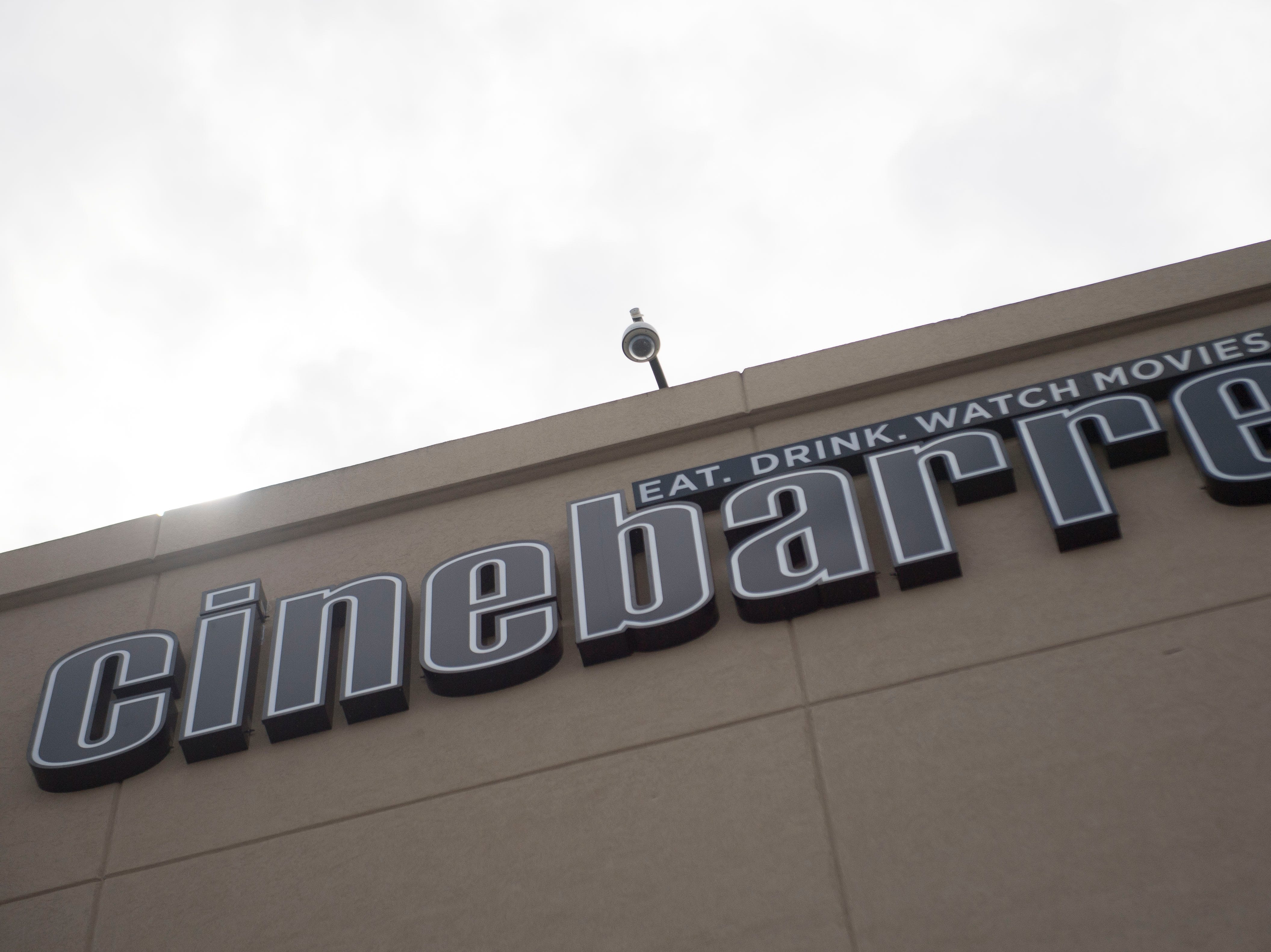 A sign marks Cinebarre at Regal's new Cinebarre location in West Town Mall Thursday, Aug. 9, 2018.
