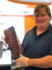 "Archer Bagley, managing partner of Archer's BBQ, is a Memphis native, and he's quite passionate about his barbecue. ""Being from Memphis, I loved barbecue,"" said Archer. ""And when I was living in Colorado, I couldn't find good barbecue, so I taught myself how to make it using my old Weber Smoky Mountain Cooker."" Under the guidance of original executive chef, Jay Barron, a Memphis native with 20 years of experience cooking barbecue, Bagley progressed from smoking three racks of meat to 30 to 40, and now 100 racks a day. Sadly, Barron has since passed away."