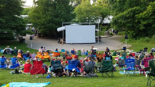 Vistors begin setting up for a movie night at Ijams Nature Center in summer 2018.