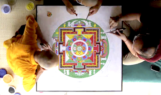 Buddhist monks create a sand mandala in Asheville, N.C. A similar mandala will be constructed Sunday through Thursday at the University of Evansville.