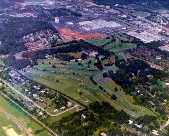 An aerial photo taken of Deane Hill Country Club in 1988. West Town Mall is at top center.