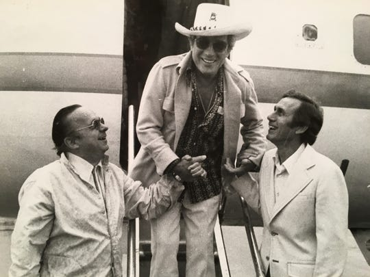 Jack Comer (left) and Chet Atkins (right) greeting Perry Como at the airport ( mid 1970s). Como was in town to partake in the Chet Atkins Celebrity Golf Tournament that Comer and Atkins hosted at Deane Hill each year.