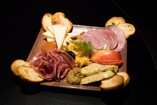 """The """"Meat v Cheese: Dawn of Just Scrumptious"""" artisan meat & cheese board at Regal's new Cinebarre location in West Town Mall Thursday, Aug. 9, 2018."""