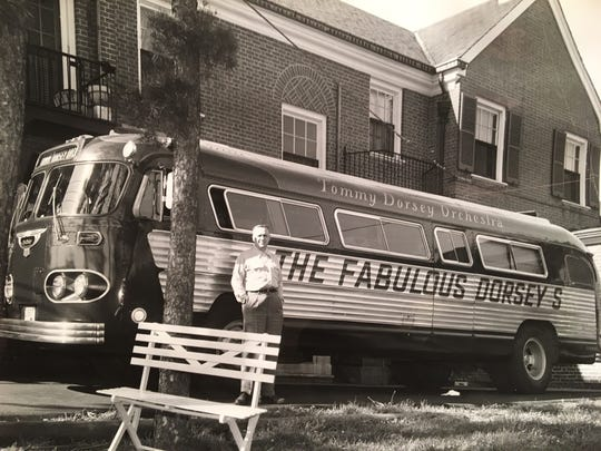 Jack Comer stands in front of the tour bus of Tommy and Jimmy Dorsey in the 1950s.
