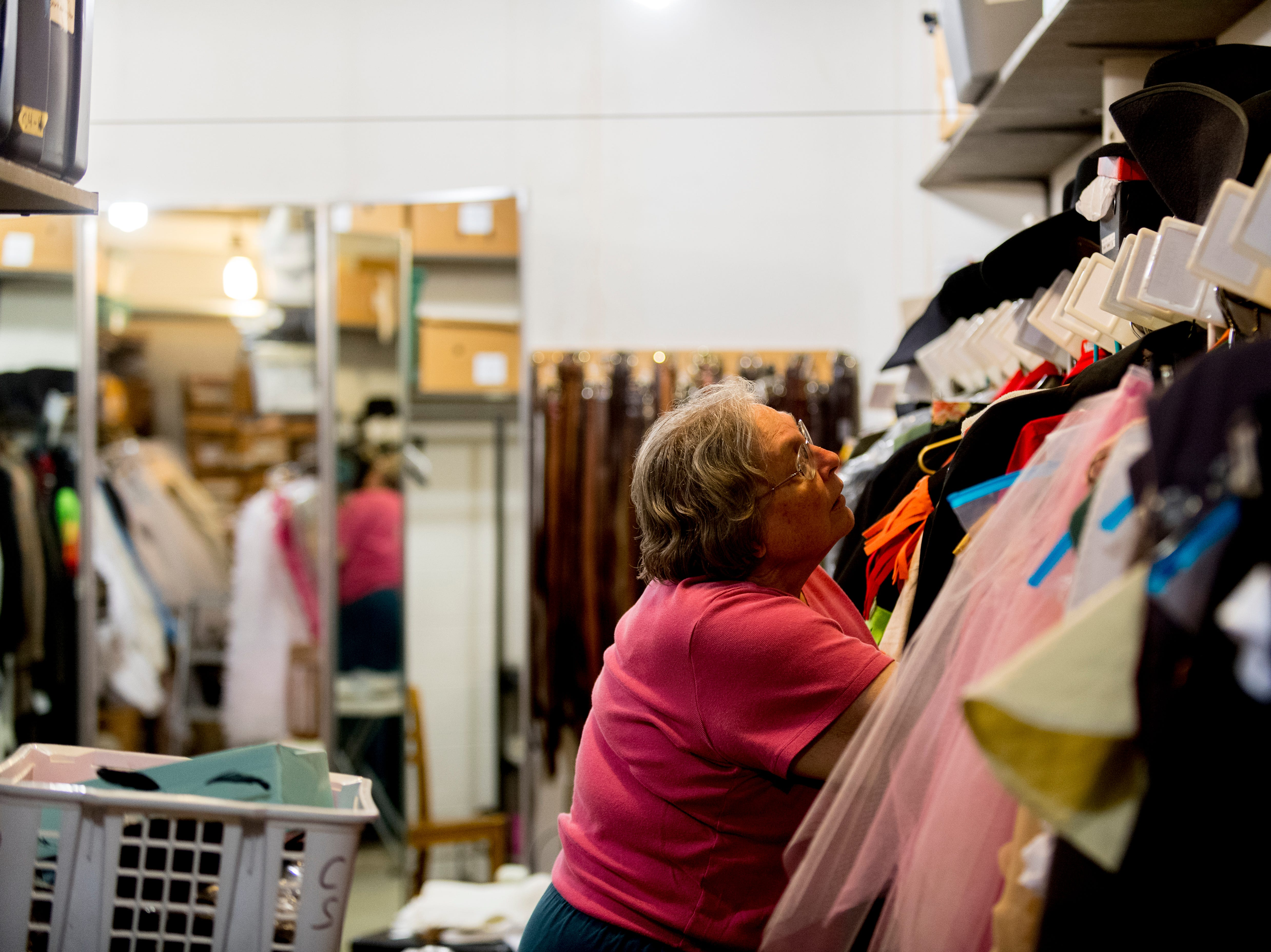Mary DeCuir looks through a rack of clothing ahead of opening day for Candide at the Clarence Brown Theatre  in Knoxville, Tennessee on Tuesday, August 14, 2018. Leonard BernsteinÕs acclaimed operetta, Candide, is to open Friday, August 31, with previews beginning August 29.